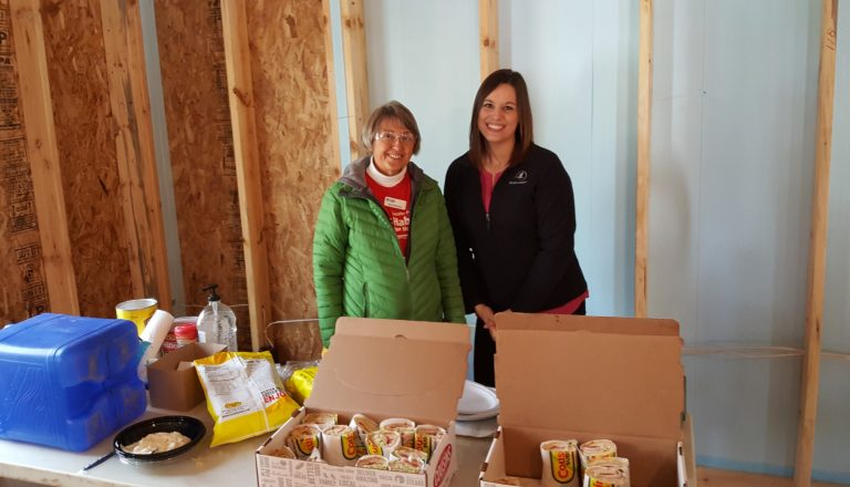 Horicon Bank employee and food pantry representative