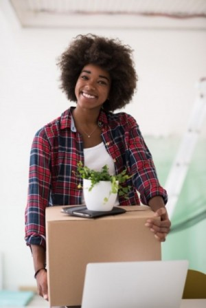 woman moving box and plant