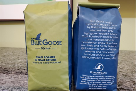 two bags of blue goose blend coffee