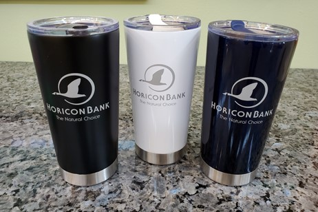three stainless steel mugs