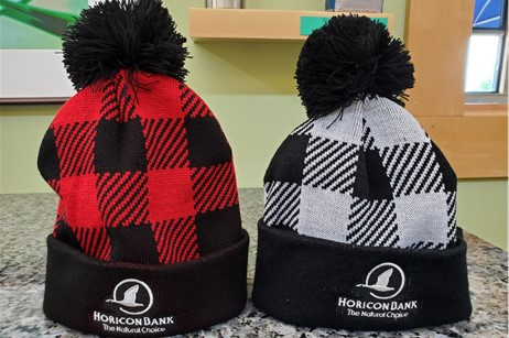 two winter knit caps with Horicon Bank logo