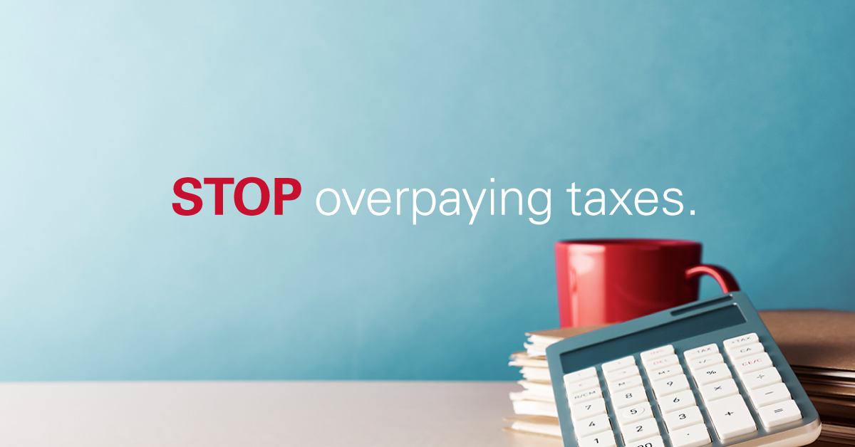 stop overpaying taxes coffee cup and calculator